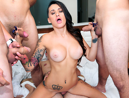 Amateur Brunette Surrounded By Dicks